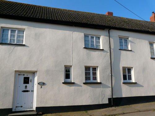 devon cob cottage with cement render modern masonry paint mike wye