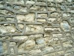 Hard Cement Pointing damage to soft stone. Close up.